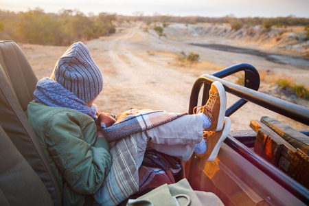 game drive: Adorable little girl wearing warm clothes outdoors on beautiful winter morning game drive