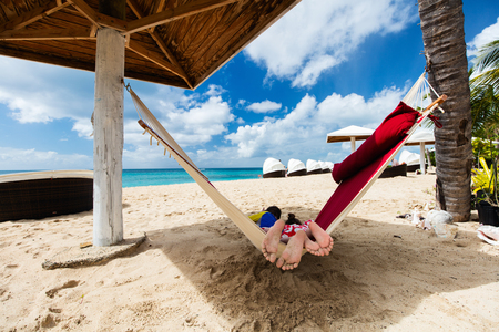 boy kid: Brother and sister kids relaxing in hammock at tropical beach Stock Photo