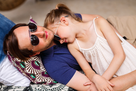 dad and daughter: Happy father and his adorable little daughter laughing together having fun