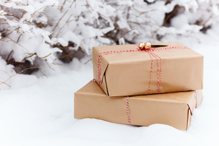 christmas ground: Christmas gift boxes on snow ground at winter day Stock Photo