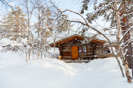 cottage: Beautiful winter landscape with wooden hut and snow covered trees Stock Photo
