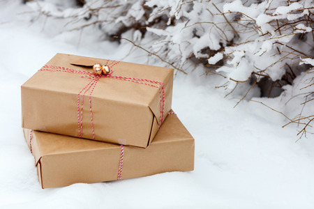 snow ground: Christmas gift boxes on snow ground at winter day Stock Photo