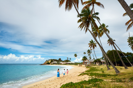 Family mother and kids enjoying tropical beach vacation Stock Photo