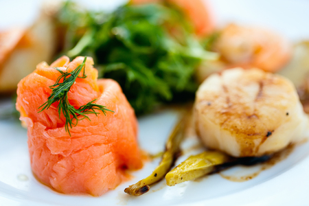 prepared dish: Close up of delicious fish and scallop served for lunch Stock Photo
