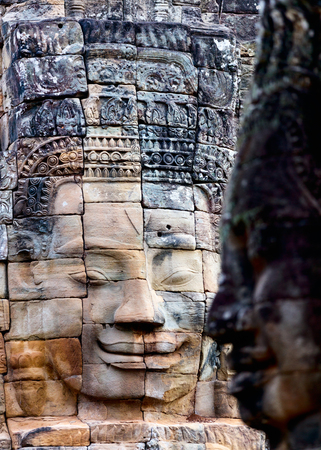 history building: Faces of ancient Bayon temple popular tourist attraction in Angkor Thom, Siem Reap, Cambodia.