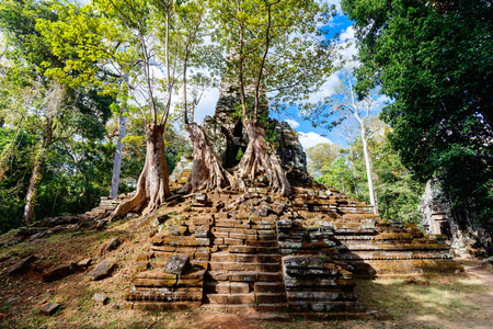 Secluded  Preah Palilay temple in Angkor Archaeological area in Cambodia Stock Photo