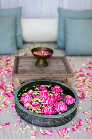 Romantic beach cabana decorated with lotus flowers