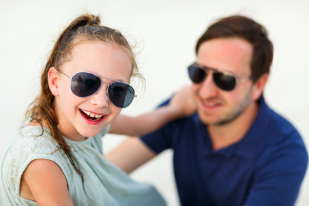 Happy father and his adorable little daughter laughing together having fun photo