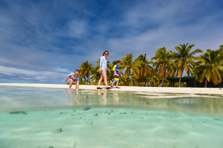 Mother and kids family at tropical beach on Aitutaki island, Cook Islands, South Pacific Stock Photo