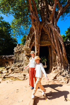 Family visiting ancient Ta Som temple in Angkor Archeological area in Cambodia