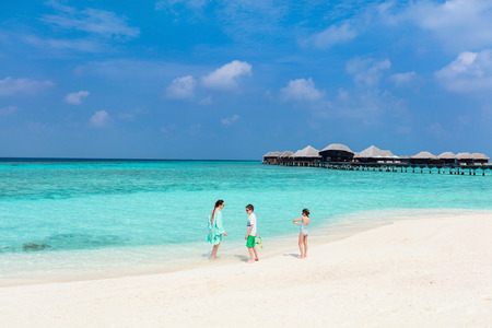 Mother and kids enjoying tropical beach vacation