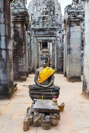 Buddha statue in Bayon temple in Angkor Archaeological area in Cambodia