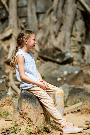 Little girl in ancient Angkor Wat temple in Siem Reap, Cambodia Reklamní fotografie