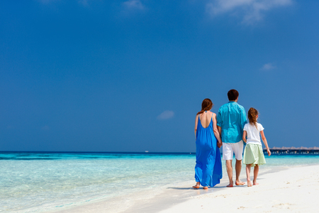 Happy beautiful family on a tropical beach vacation photo