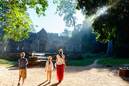 Family visiting ancient Preah Khan temple in Angkor Archaeological area in Cambodia Stock Photo