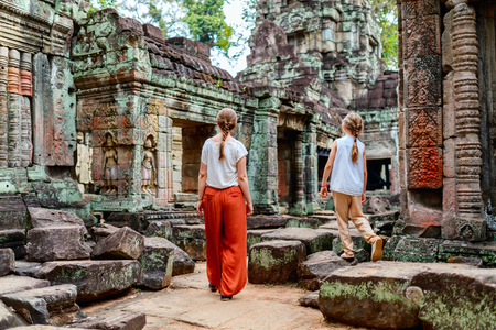 Family visiting ancient Preah Khan temple in Angkor Archeological area in Cambodia