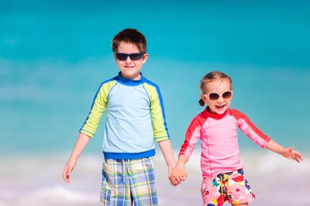 Two little kids at a tropical beach photo