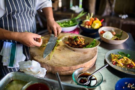 Chef making traditional cambodian meat dish at cooking class