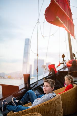 Tourist kids sailing in Hong Kong harbour Stock Photo