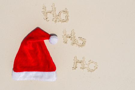 Santa hat on a white sand tropical beach Stok Fotoğraf