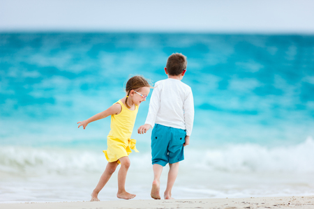 children crab: Kids having fun at tropical beach during summer vacation playing together