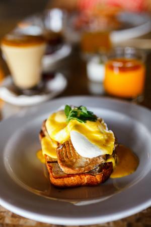 benedict: Delicious breakfast with eggs Benedict and juice Stock Photo