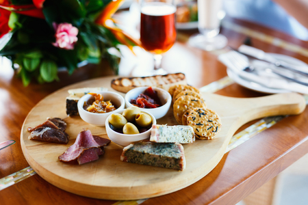 Selection of different delicious appetizers on beer platter Stock Photo
