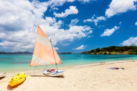 Kayaks at beautiful tropical Caribbean beach