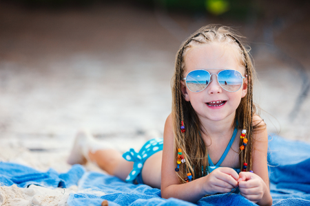 Adorable little girl with Caribbean braids on vacation