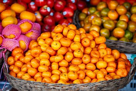 Selection of fresh oranges at market for sale