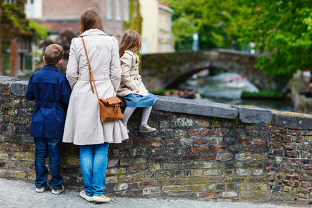 Mother and her kids outdoors in European city