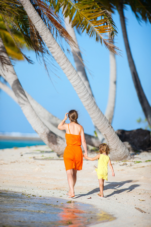 Back view of mother and daughter on a deserted island Stock Photo