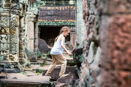 Little girl at ancient Preah Khan temple in Angkor Archaeological area in Cambodia Stock fotó