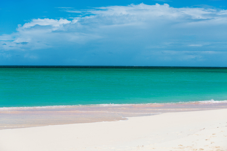 Idyllic tropical beach on Barbuda island in Caribbean with pink sand, turquoise ocean water and blue sky Stock Photo