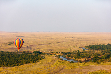 Early morning flight of hot balloons over Masai Mara national park, Kenya Reklamní fotografie