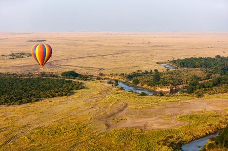 Early morning flight of hot balloons over Masai Mara national park, Kenya Stock Photo