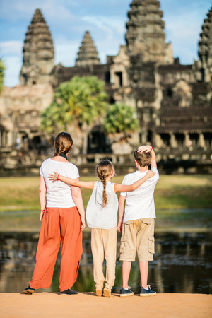 Family visiting ancient Angkor Wat temple in Siem Reap in Cambodia