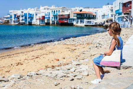 Cute little girl at Little Venice popular tourist area on Mykonos island, Greece
