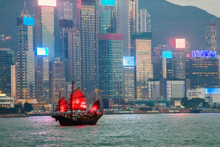 Junk boat with red sail in Hong Kong