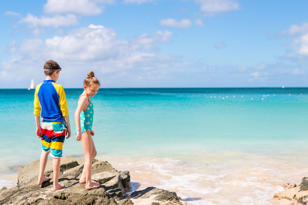 Kids brother and sister at tropical beach during Caribbean summer vacation Stock Photo