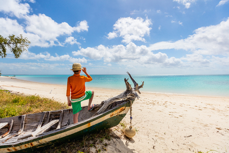 Back view of boy on vacation at tropical beach Stock Photo