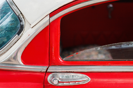 Close up of a bright red vintage car detail