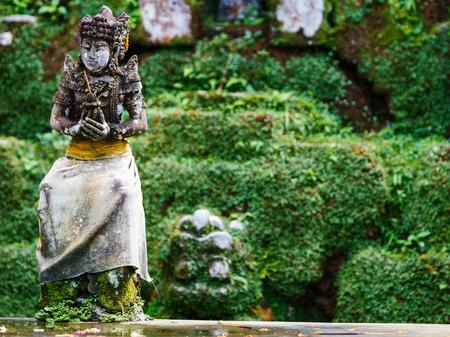 Beautiful stone Balinese statue