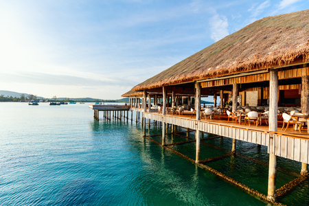 Tropical overwater bar in a luxury resort 스톡 콘텐츠