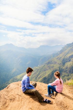 Kids enjoying breathtaking views over mountains and tea plantations from Little Adams peak in Ella Sri Lanka