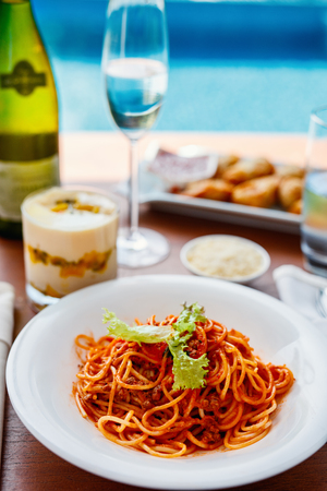 Delicious spaghetti bolognese served for lunch at luxury resort or restaurant Фото со стока