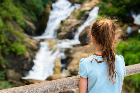 Young girl enjoying views over Ravana Ella waterfalls in Sri Lanka from a viewpoint Stok Fotoğraf