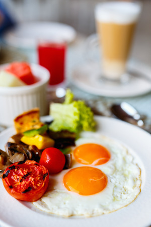 Delicious breakfast with fried eggs, bacon and vegetables Reklamní fotografie