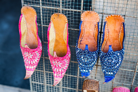 Traditional colorful slippers for sale at Souq Waqif arabic market in Doha Stock Photo