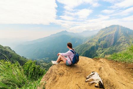 Young woman enjoying breathtaking views over mountains and tea plantations from Little Adams peak in Ella Sri Lanka Stock Photo - 96052312